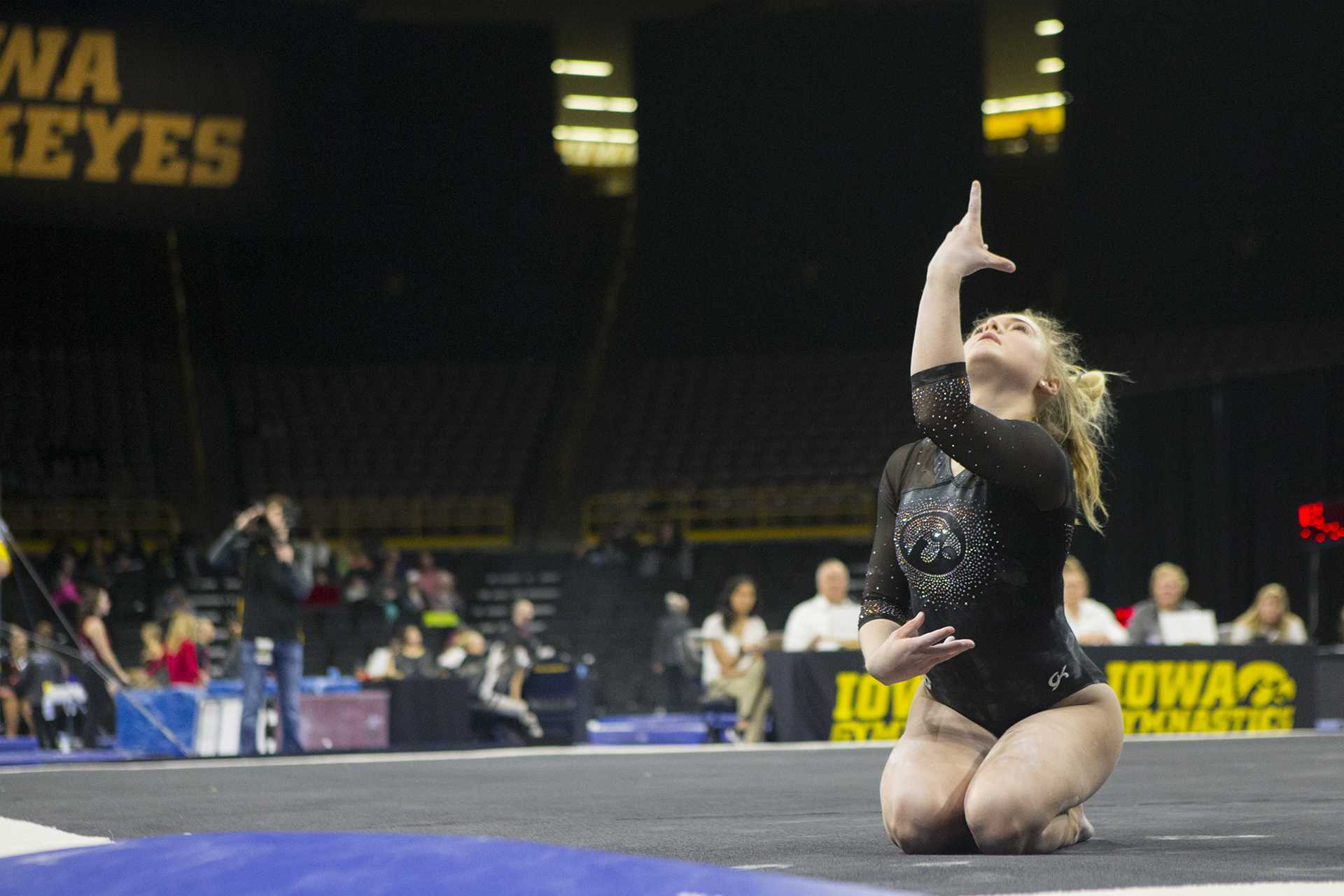 Iowa's Charlotte Sullivan performs on the floor during the Iowa/Ohio State gymnastics meet in Carver-Hawkeye Arena on Friday, Jan. 19, 2018. The GymHawks defeated the Buckeyes, 195.725 to 195.300, to win their home opener. (Lily Smith/The Daily Iowan)
