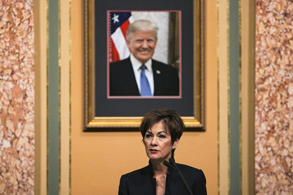 Iowa+Gov.+Kim+Reynolds+speaks+while+a+portrait+of+President+Donald+Trump+hangs+above+her+during+her+first+Condition+of+the+State+address+in+the+Iowa+State+Capitol+in+Des+Moines+on+Tuesday%2C+Jan.+9%2C+2018.+Reynolds+took+over+the+governor+office+in+May+of+2017.+