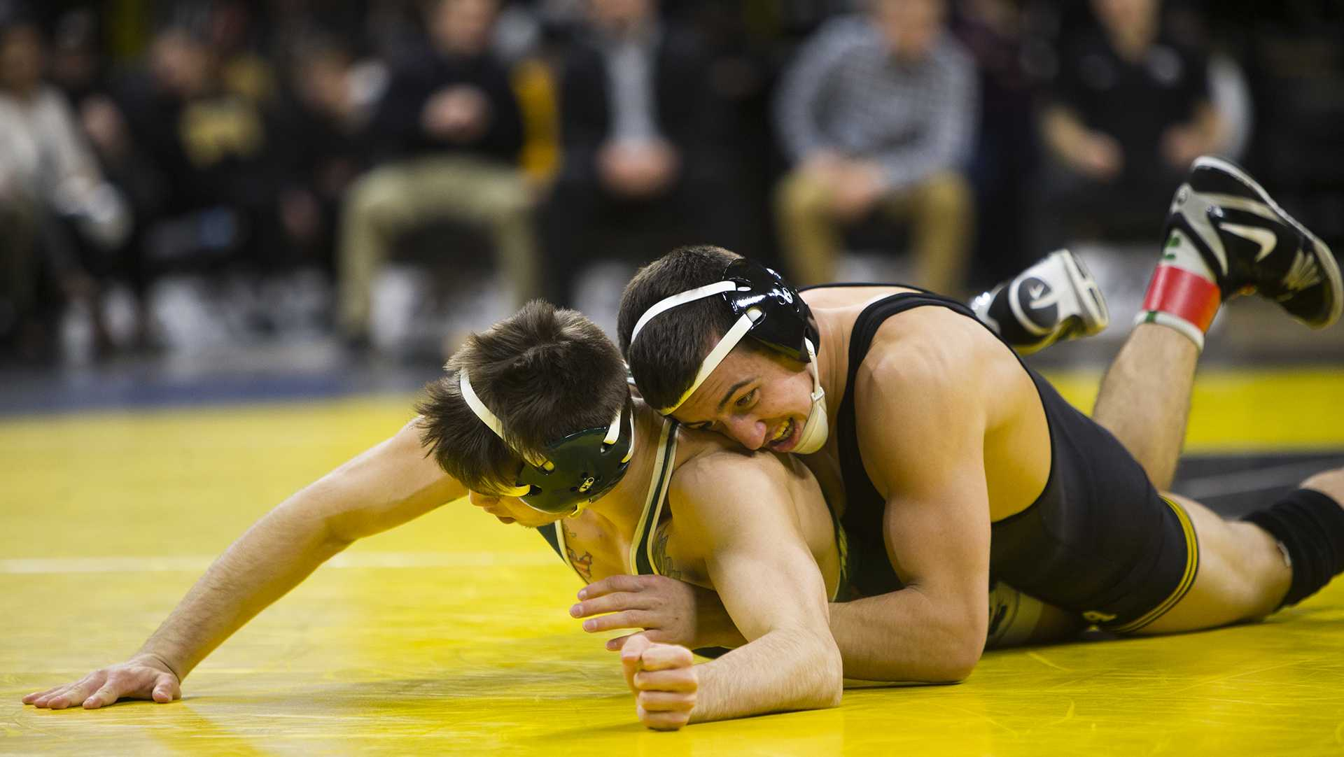 Iowa's No. 2 157-pound Michael Kemerer wrestles Michigan State's Jake Tucker during an Iowa/Michigan State wrestling matchup in Carver-Hawkeye Arena on Friday, Jan. 5, 2018. Kemerer pinned Tucker in 4:21. (Joseph Cress/The Daily Iowan)