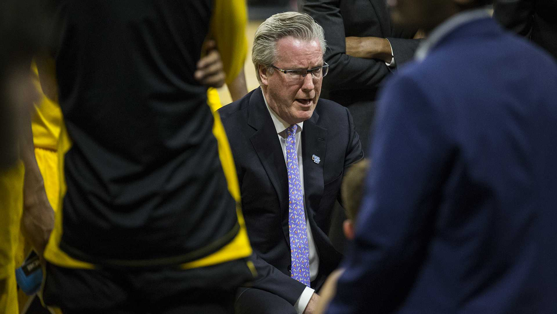 Iowa head coach Fran McCaffery speaks to his players during a timeout in the NCAA men's basketball game between Iowa and Wisconsin at Carver-Hawkeye Arena on Tuesday, Jan. 23, 2018. The Hawkeyes are going into the game with a conference record of 1-7. Iowa went on to defeat Wisconsin 85-67. (Ben Allan Smith/The Daily Iowan)