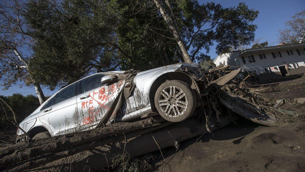 A car atop trees and debris in the rubble of a home in the aftermath of mudslides in the 300 block of Hot Springs Rd.in Montecito, Calif., on Jan. 12, 2018. (Brian van der Brug/Los Angeles Times/TNS)