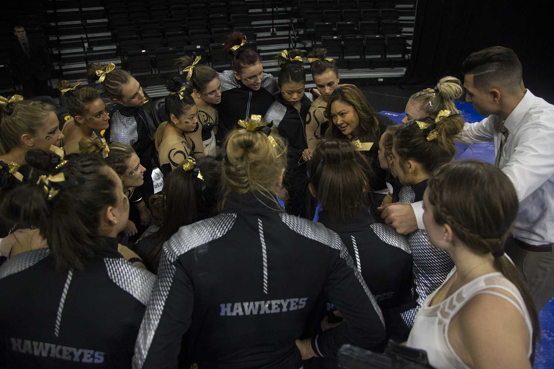 Iowa head coach Larissa Libby huddles with her athletes during a women's gymnastics meet in Carver-Hawkeye Arena on Friday, Jan. 13, 2017. The Hawkeyes defeated the Spartans, 195.475-193.875. (The Daily Iowan/Joseph Cress)