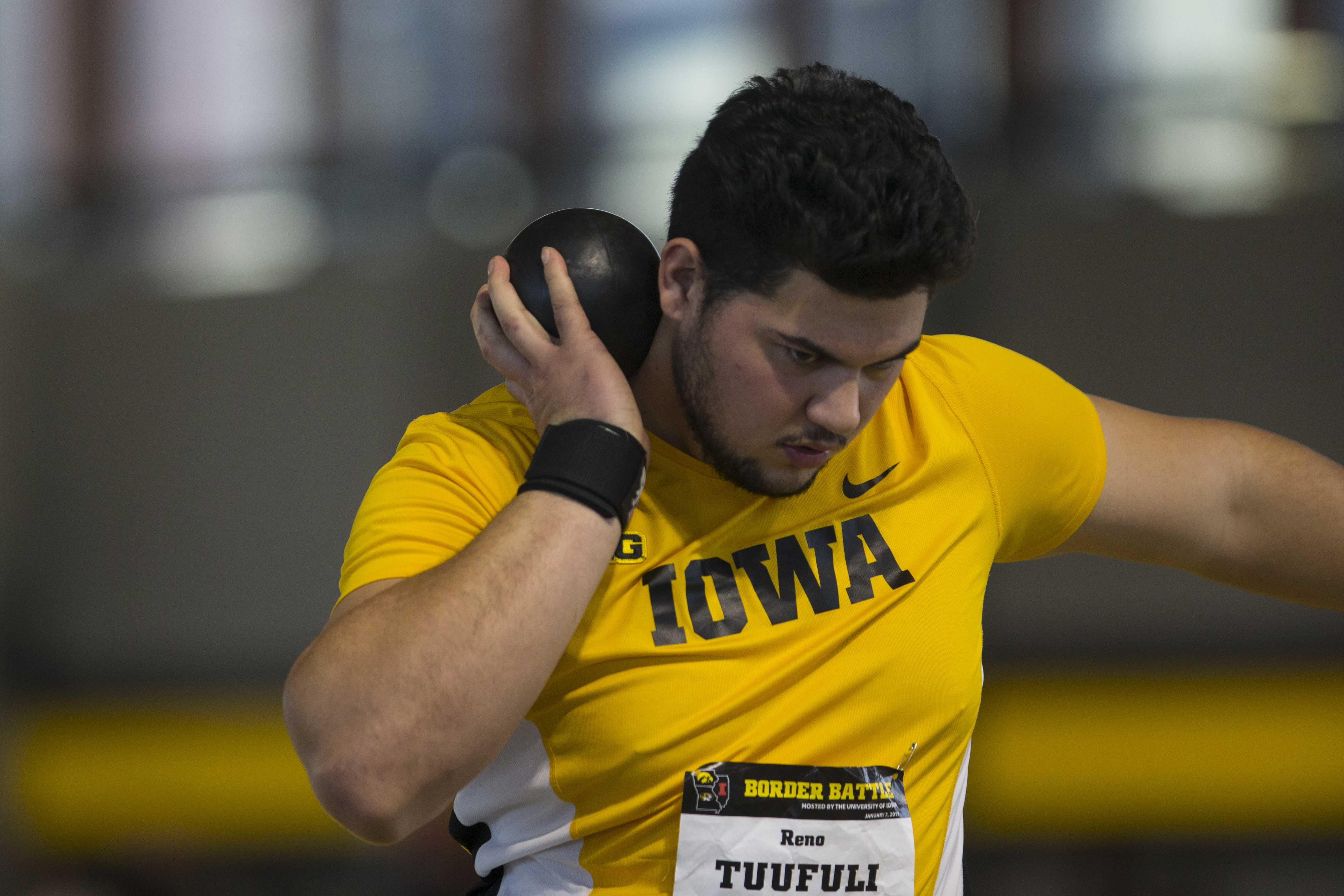 Iowa sophomore Reno Tuufuli attempts a throw during the Border Battle indoor track meet in the UI Recreation Building with Iowa, Missouri and Illinois competing on Saturday, Jan. 7, 2017. The Hawkeye women defeated Missouri and Illinois, 105-33 and 96-51 respectively, while the men defeated Missouri, 107-27 and fell to Illinois, 85-74. (The Daily Iowan/Joseph Cress)