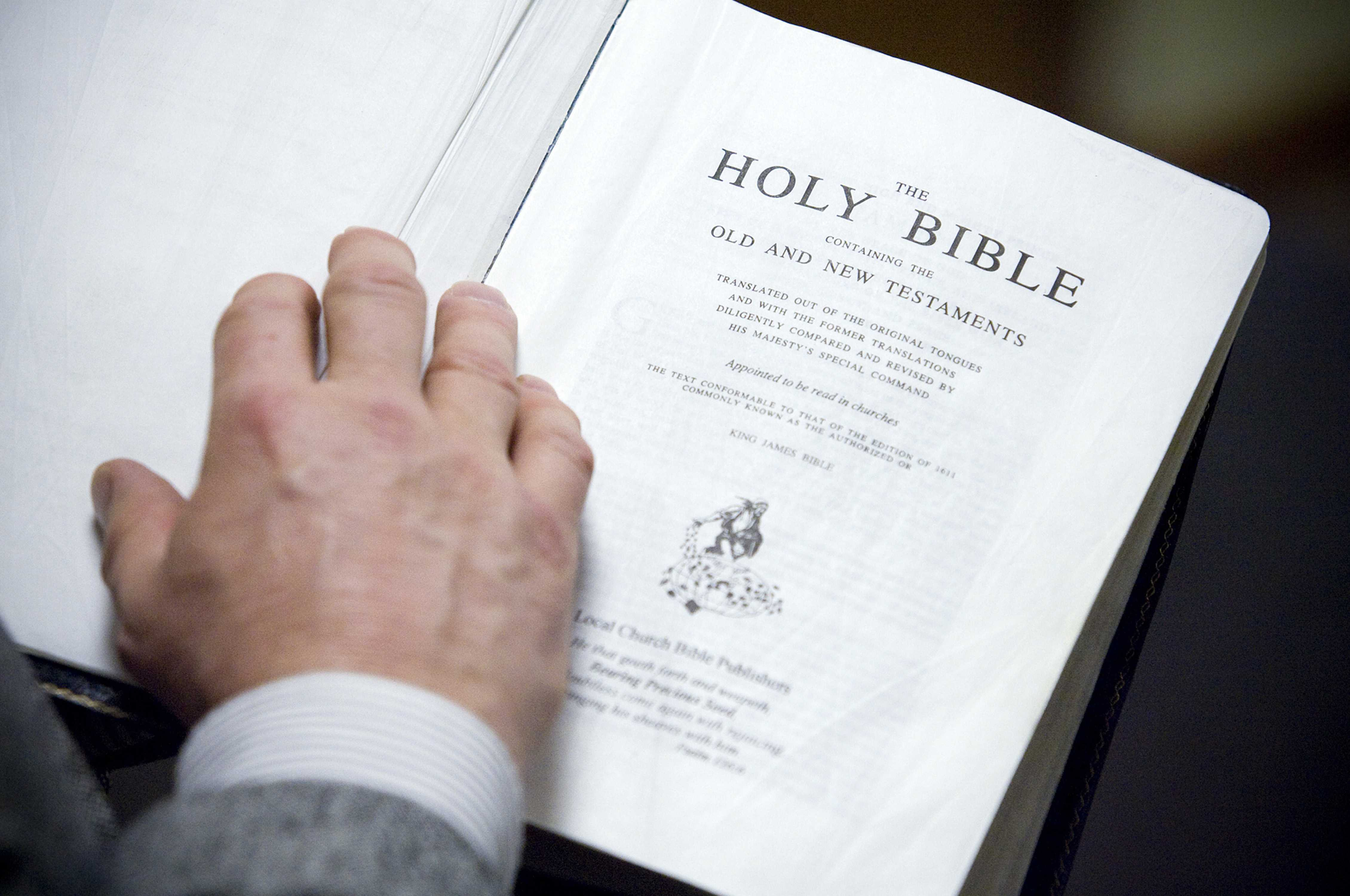 Pastor Chris Huff, of Bible Baptist Church, in Mount Prospect, Illinois, holds his copy of the King James translation of the Bible, March 2, 2011. (Darrell Goemaat/Chicago Tribune/TNS)