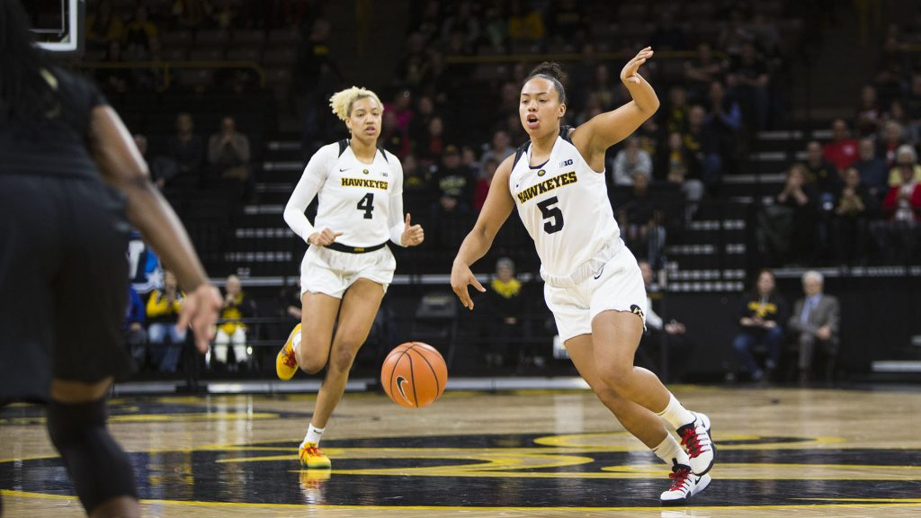Iowa+guard+Alexis+Sevillian+gestures+to+teammate+while+taking+the+ball+up+the+court+during+an+Iowa%2FPurdue+women%27s+basketball+game+in+Carver-Hawkeye+Arena+on+Saturday%2C+Jan.+13%2C+2018.+The+Boilermakers+defeated+the+Hawkeyes%2C+76-70.+%28Joseph+Cress%2FThe+Daily+Iowan%29