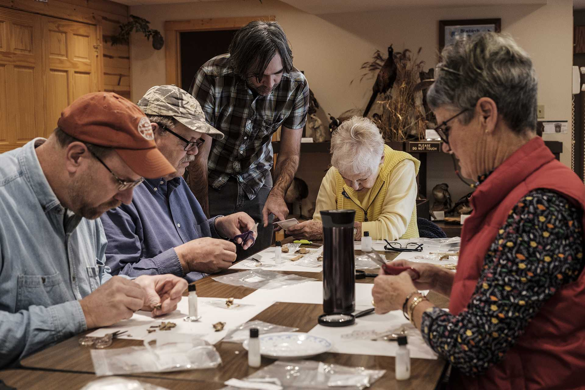 Archaeologist Bryan Kendall of the Office of the State Archaeologist instructs volunteers as they label artifacts on Friday, Jan. 19, 2018. Artifacts included both historic and prehistoric animal bones and pottery fragments. (Nick Rohlman/The Daily Iowan)