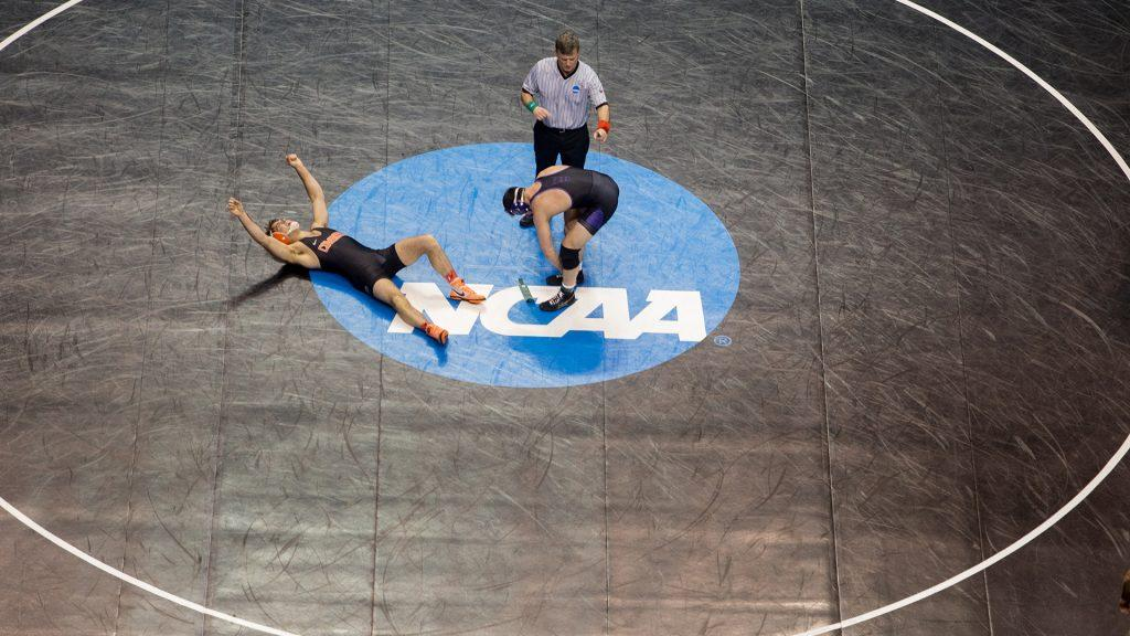 A wrestler celebrates his victory during the 2017 NCAA Division I Wrestling Championships in the Scottrade Center in St. Louis, Missouri on Friday, March 17, 2017. Day two of the National Championships shrinks the number of competitors down to the final competition for the Championship match on Saturday. (The Daily Iowan/Anthony Vazquez)