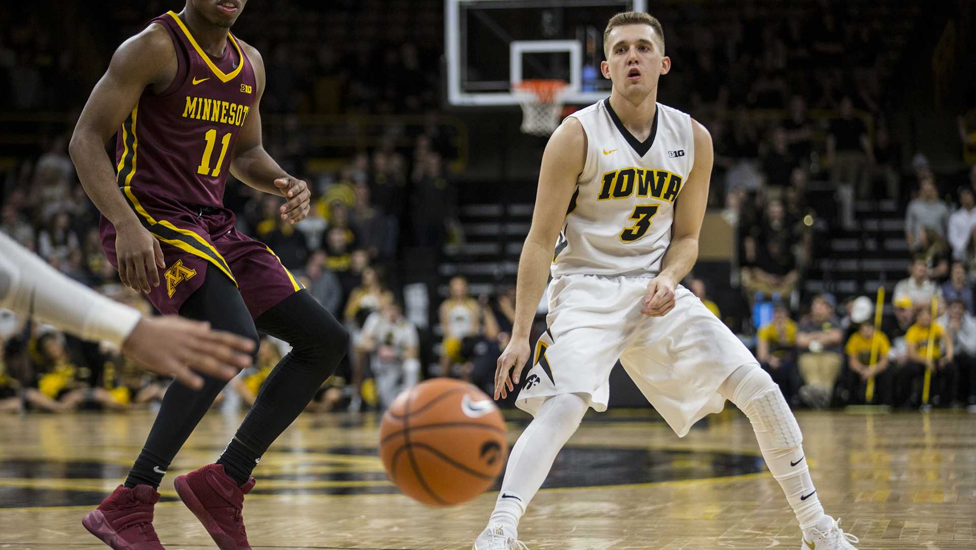 Iowa's Jordan Bohannon (3) passes the ball to a teammate during the NCAA men's basketball game between Iowa and Minnesota at Carver-Hawkeye Arena on Tuesday, Jan. 30, 2018. The Hawkeyes are going into the game with a Big Ten conference record of 2-8. Iowa went on to defeat the Golden Gophers 94-80. (Ben Allan Smith/The Daily Iowan)