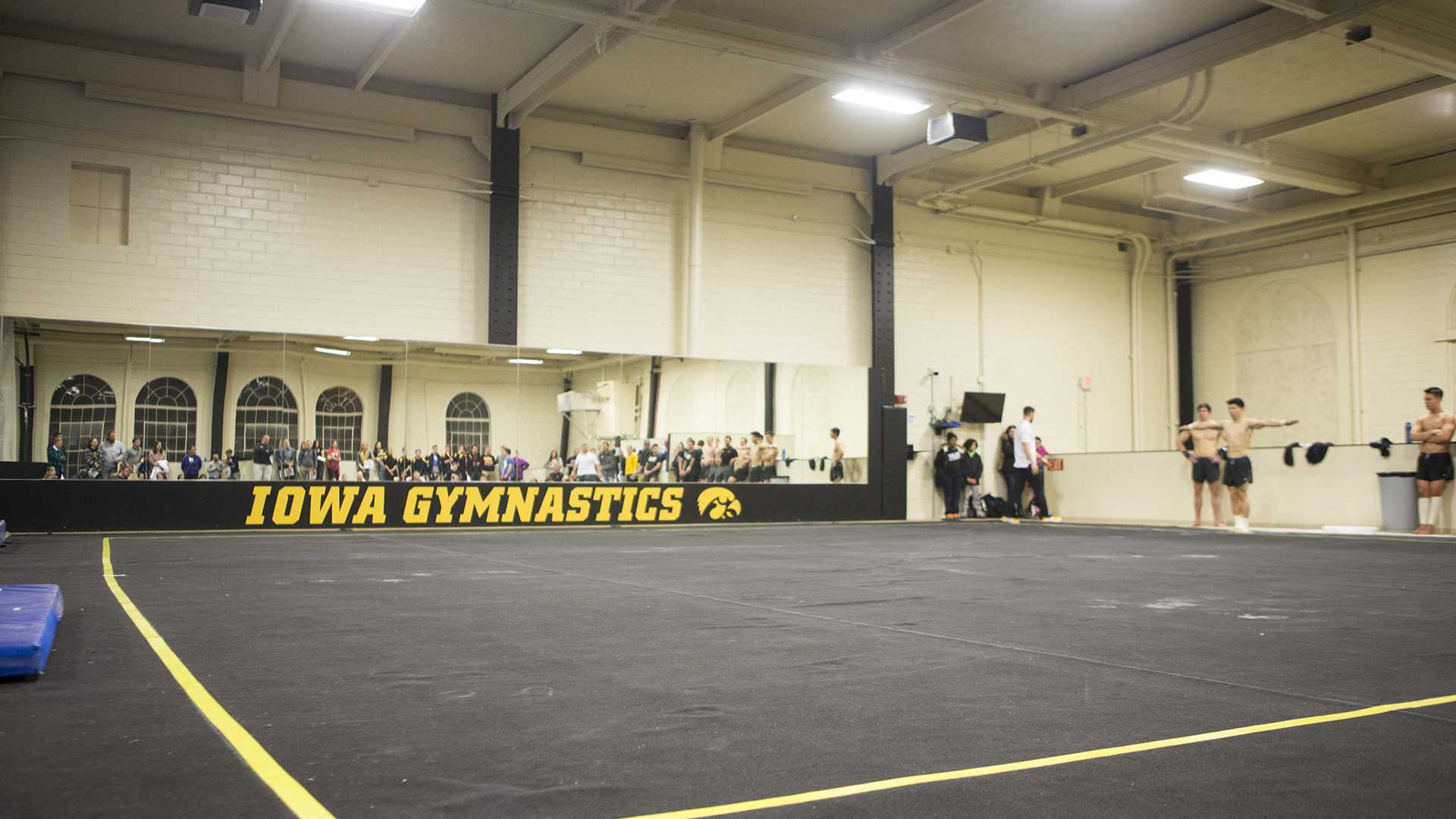 Gymnasts prepare to perform floor routines during the Black and Gold intrasquad in the Field House on Friday, Dec. 1, 2017. The Hawkeyes men's gymnastics team debuted their 2018 roster during the event. (Joseph Cress/The Daily Iowan)