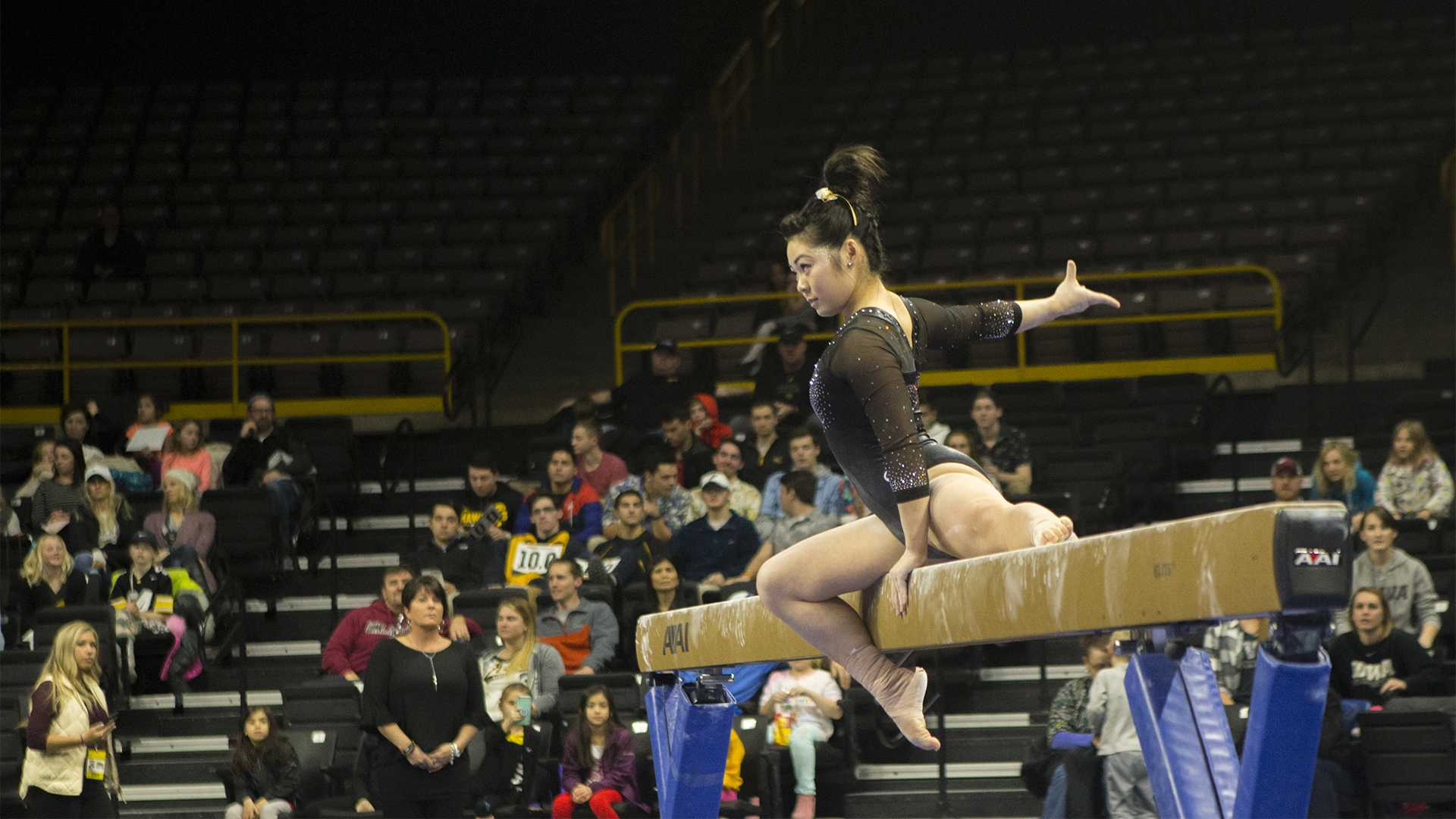 Iowa's Clair Kaji performs on the beam during the Iowa/Ohio State gymnastics meet in Carver-Hawkeye Arena on Friday, Jan. 19, 2018. The GymHawks defeated the Buckeyes, 195.725 to 195.300, to win their home opener. (Lily Smith/The Daily Iowan)
