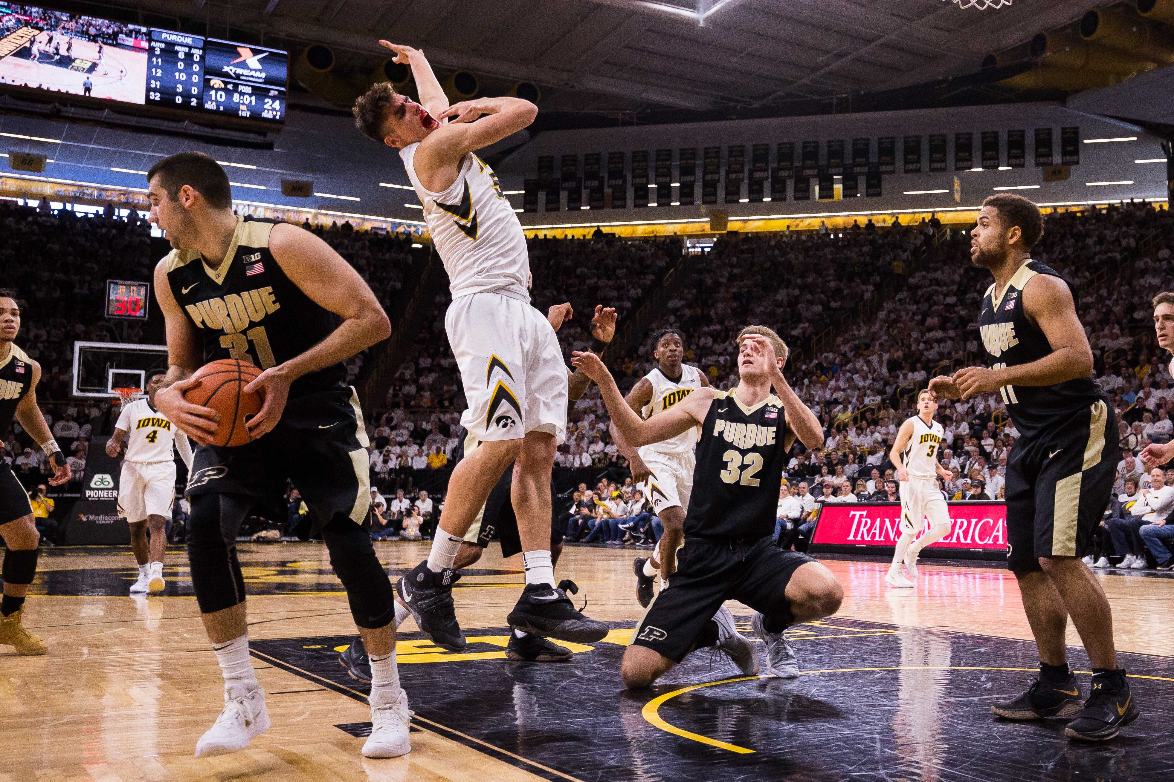 Iowa forward Luka Garza comes up bloodied after fighting for a rebound during a game against Purdue University on Saturday, Jan. 20, 2018. The Boilermakers defeated the Hawkeyes 87-64. (David Harmantas/The Daily Iowan)
