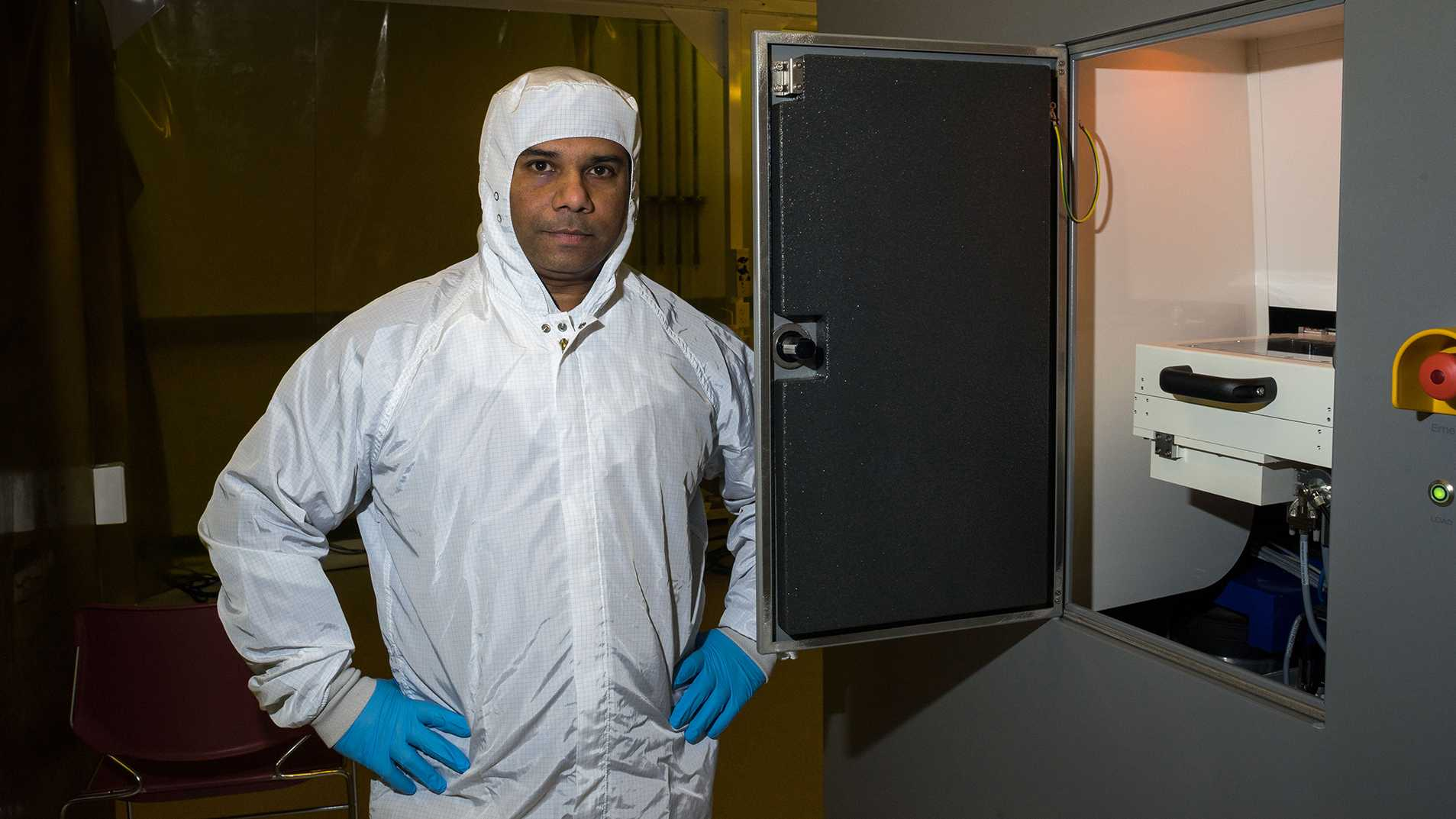 Dr. Aju Jugessur stands in front of one of the machines used in his lab at the Iowa Advanced Technology Laboratory on Tuesday, Jan. 23, 2018. Dr. Jugessur is the director of the University of Iowa Microfabrication Facility.