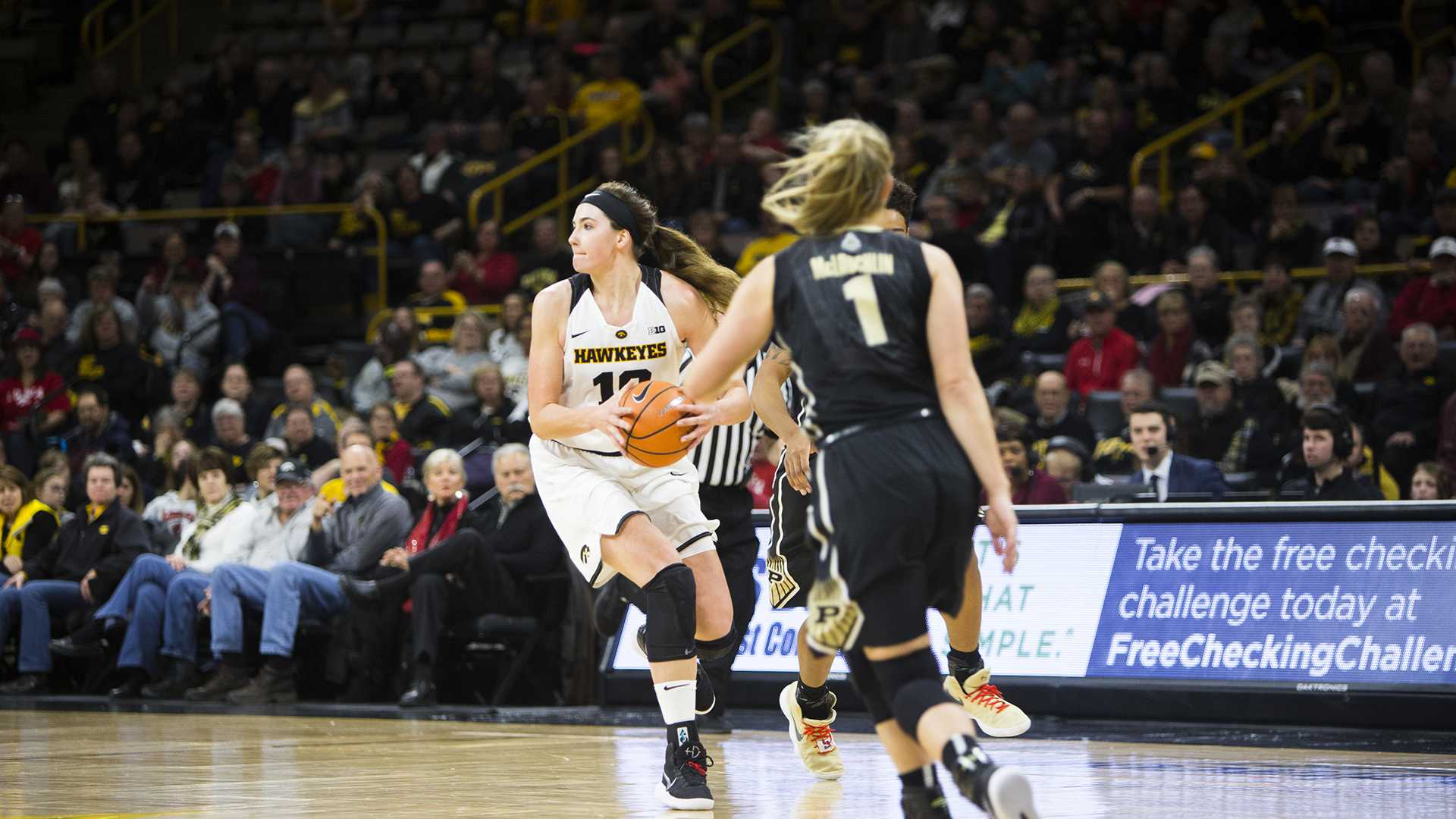 Iowa center Megan Gustafson looks to pass during an Iowa/Purdue women's basketball game in Carver-Hawkeye Arena on Saturday, Jan. 13, 2018. The Boilermakers defeated the Hawkeyes, 76-70. (Joseph Cress/The Daily Iowan)