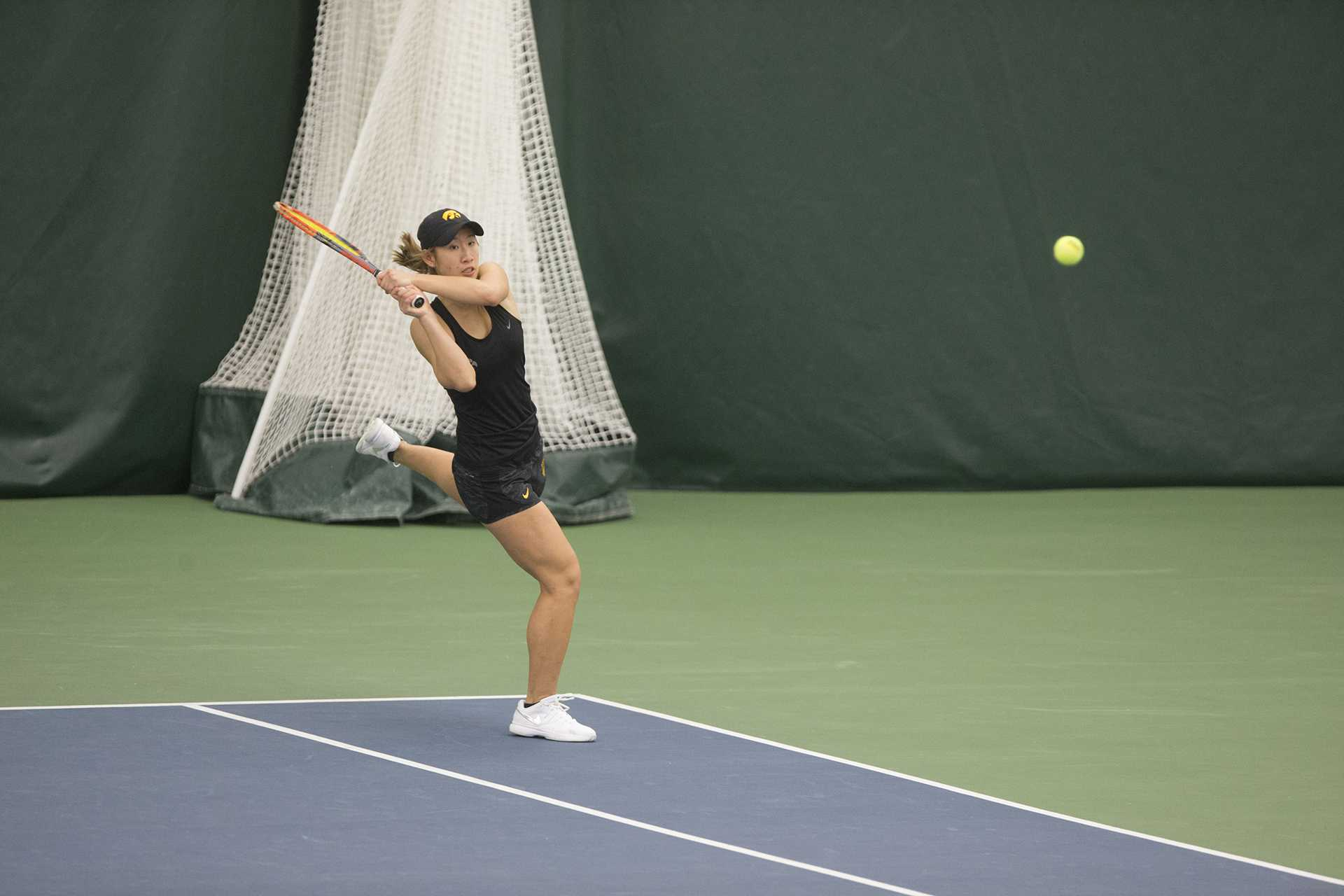 Iowa's Yufei Long wails a backhand during a tennis match between Iowa and Northern Iowa in Iowa City on Saturday, Jan. 20, 2018. The Hawkeyes defeated the Panthers, 7-0. (Shivansh Ahuja/The Daily Iowan)