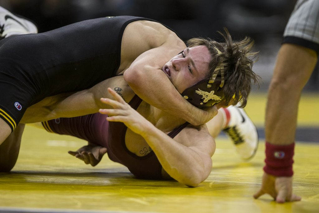 Minnesota%27s+133-pound+Mitch+McKee+competes+against+Iowa%27s+Paul+Glynn+during+the+NCAA+wrestling+match+between+Iowa+and+Minnesota+at+Carver-Hawkeye+Arena+on+Friday%2C+Feb.+2%2C+2018.+