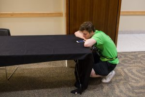 A dance marathon participant checks their cell phone during the eighth hour of the University of Iowa 24th Annual Dance Marathon, on Saturday, Feb. 3, 2017. (David Harmantas/The Daily Iowan)