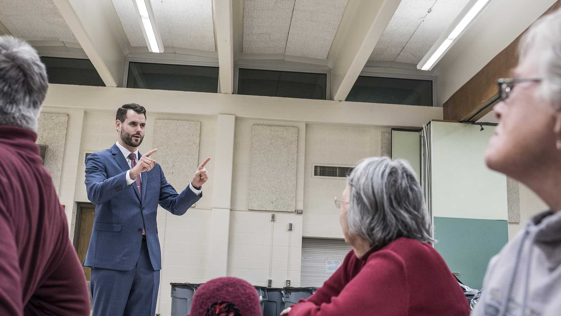 Candidate for the Iowa State Legislature and UI alum Zach Wahls speaks to Iowa City residents during the off season gubernatorial Democratic caucuses at Iowa City-West High School on Monday, Feb. 5, 2018. Representatives for candidates such as Fred Hubbell, Nate Boulton, John Norris, and Deidre Dejear were in attendance. (Ben Allan Smith/The Daily Iowan)