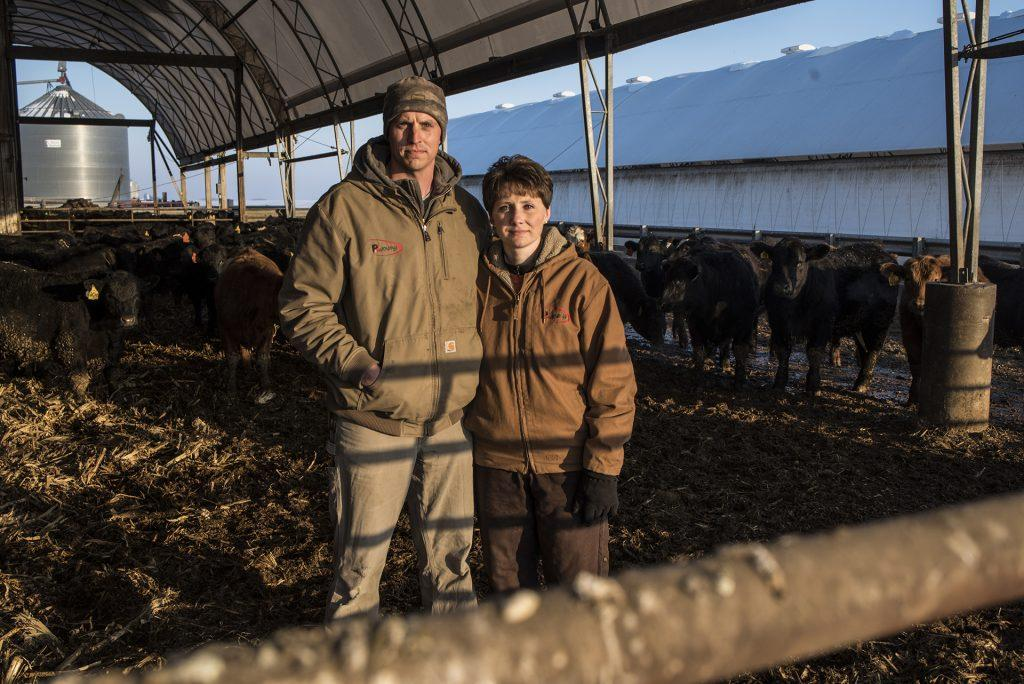 Laura and Pat Blomme stand inside a cow pen on their family farm in Ladora, Iowa on Tuesday, Feb. 13, 2018. The farm, which produces corn, soybeans, pork, and beef, has been in the family for over 80 years.
