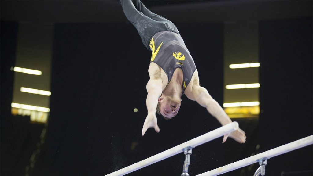 Dylan+Ellsworth+competes+on+the+parallel+bars+during+men%27s+gymnastics+on+Feb.+23%2C+2018.+Ellsworth+13.750+for+his+performance+on+the+parallel+bars.+The+Cornhusters+defeated+the+Hawkeyes+402.8+to+398.5.+%28Katie+Goodale%2F+The+Daily+Iowan%29