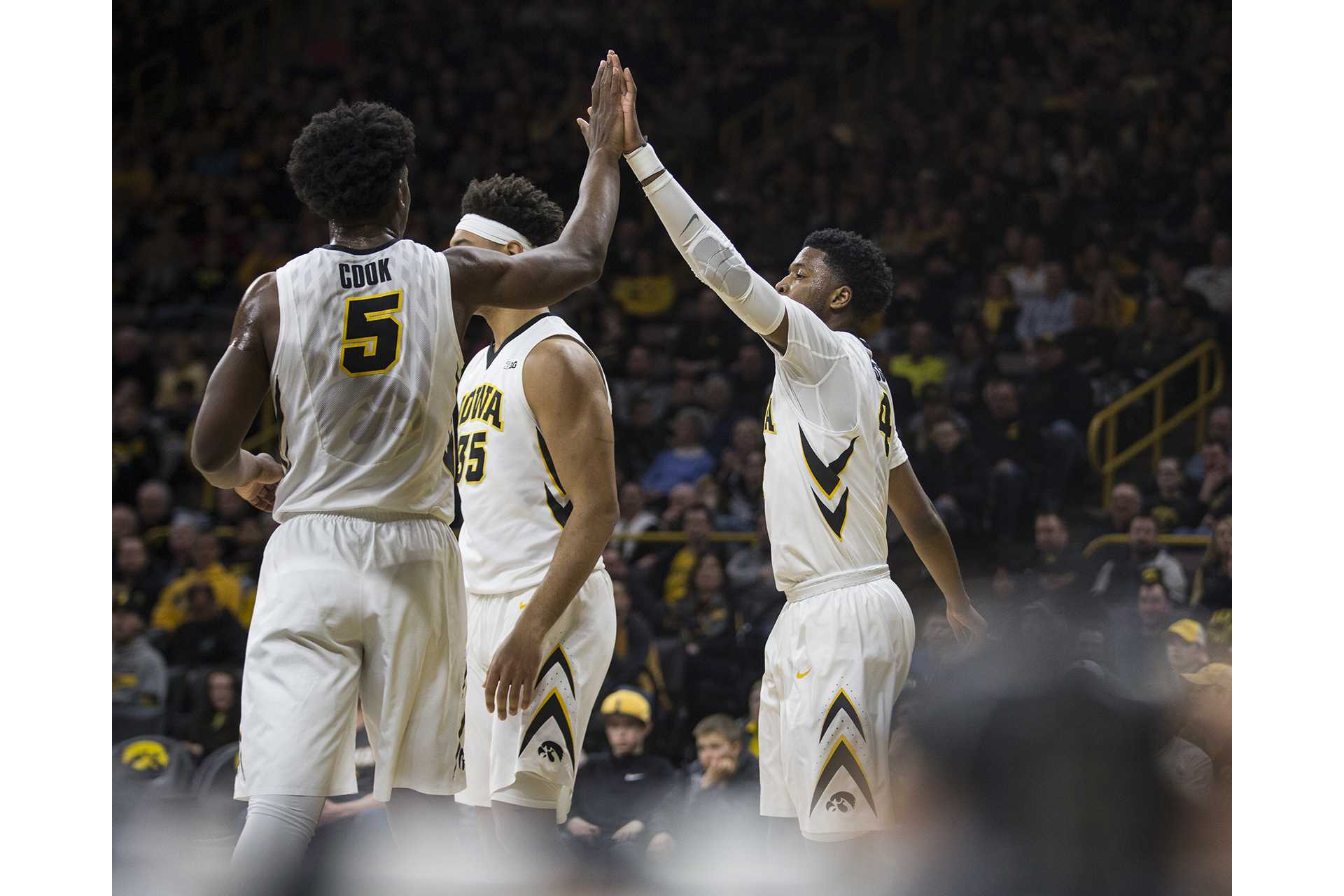 Iowa's Isaiah Moss (right) and Tyler Cook (left) high five during the Senior Day men's basketball game between Iowa and Northwestern at Carver-Hawkeye Arena on Sunday, Feb. 25, 2018. The Hawkeyes defeated the Wildcats 77-70. (Ben Allan Smith/The Daily Iowan)