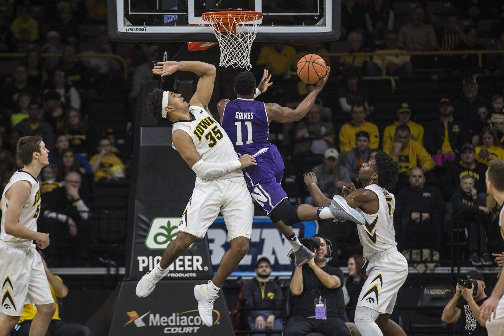 Iowas Cordell Pemsl (35) attempts to block a shot by Northwesterns Anthony Gaines (11) during the Senior Day mens basketball game between Iowa and Northwestern at Carver-Hawkeye Arena on Sunday, Feb. 25, 2018. The Hawkeyes defeated the Wildcats 77-70. (Ben Allan Smith/The Daily Iowan)