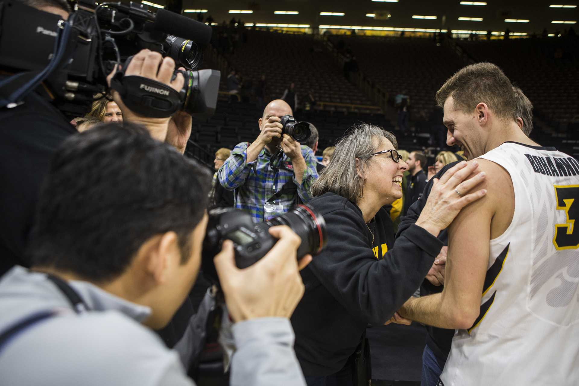 Iowa fans congratulate Jordan Bohannon (3) after the Senior Day men's basketball game between Iowa and Northwestern at Carver-Hawkeye Arena on Sunday, Feb. 25, 2018. The Hawkeyes defeated the Wildcats 77-70. (Ben Allan Smith/The Daily Iowan)