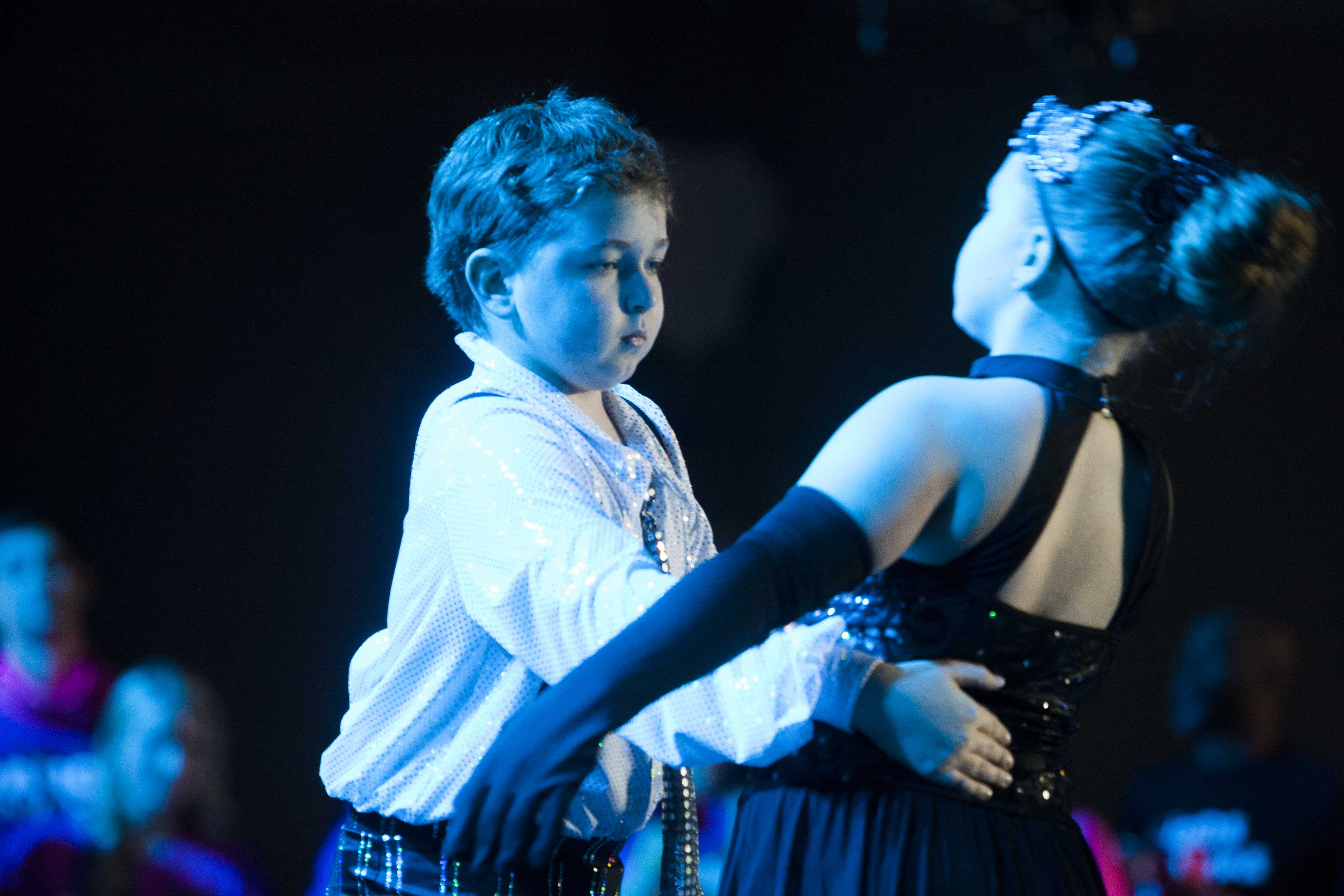 Molly and Joseph Burken perform during UI Dance Marathon 24 at the IMU on Saturday, Feb. 3, 2018. Joseph was diagnosed with a brain tumor at age 5. (Shivansh Ahuja/The Daily Iowan)