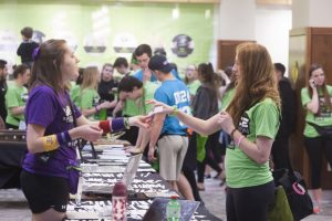 Participants walk to information tables during UI Dance Marathon 24 at the IMU on Saturday, Feb. 3, 2018. (Shivansh Ahuja/The Daily Iowan)
