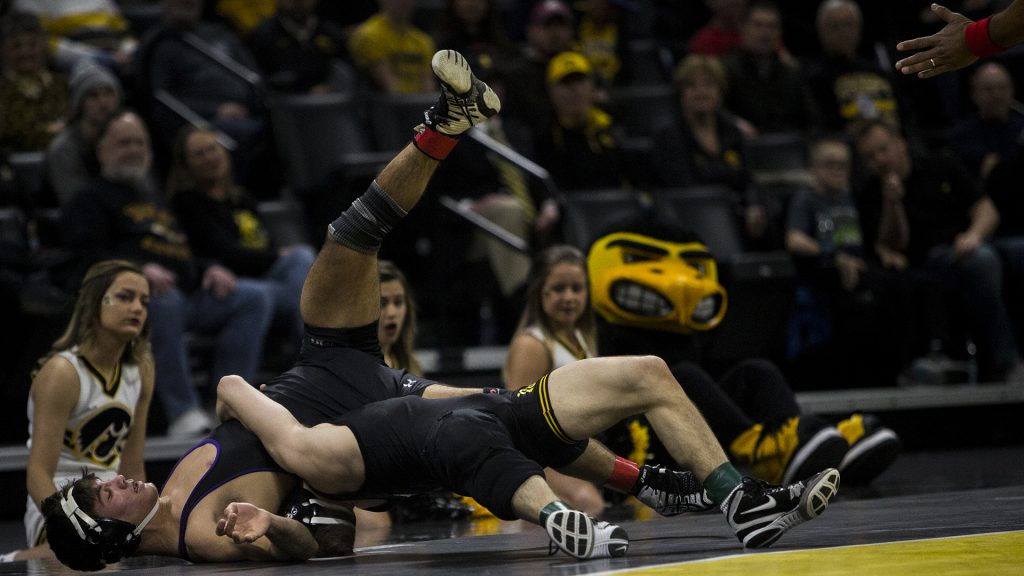 Iowa%27s+%233+ranked+125+pound+Spencer+Lee+wrestles+Northwestern%27s+%2310+ranked+Sebastian+Rivera+during+the+Iowa+vs.+Northwestern+dual+meet+on+Sunday%2C+Feb.+4%2C+2018.+The+Hawkeyes+defeated+the+wildcats+33-2.+%28Nick+Rohlman%2FThe+Daily+Iowan%29