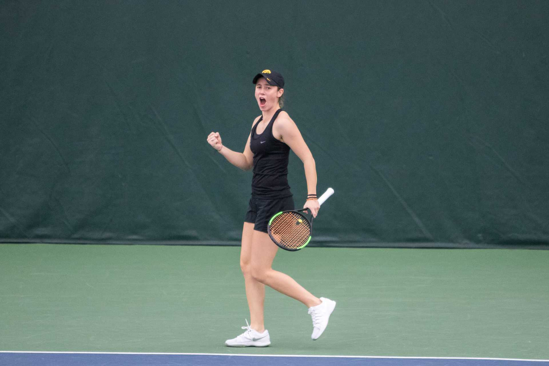 Iowa tennis player Elise van Heuvelen celebrates winning a match during a match against Marquette University on Sunday, Feb. 25, 2018 at the Hawkeye Tennis Complex.