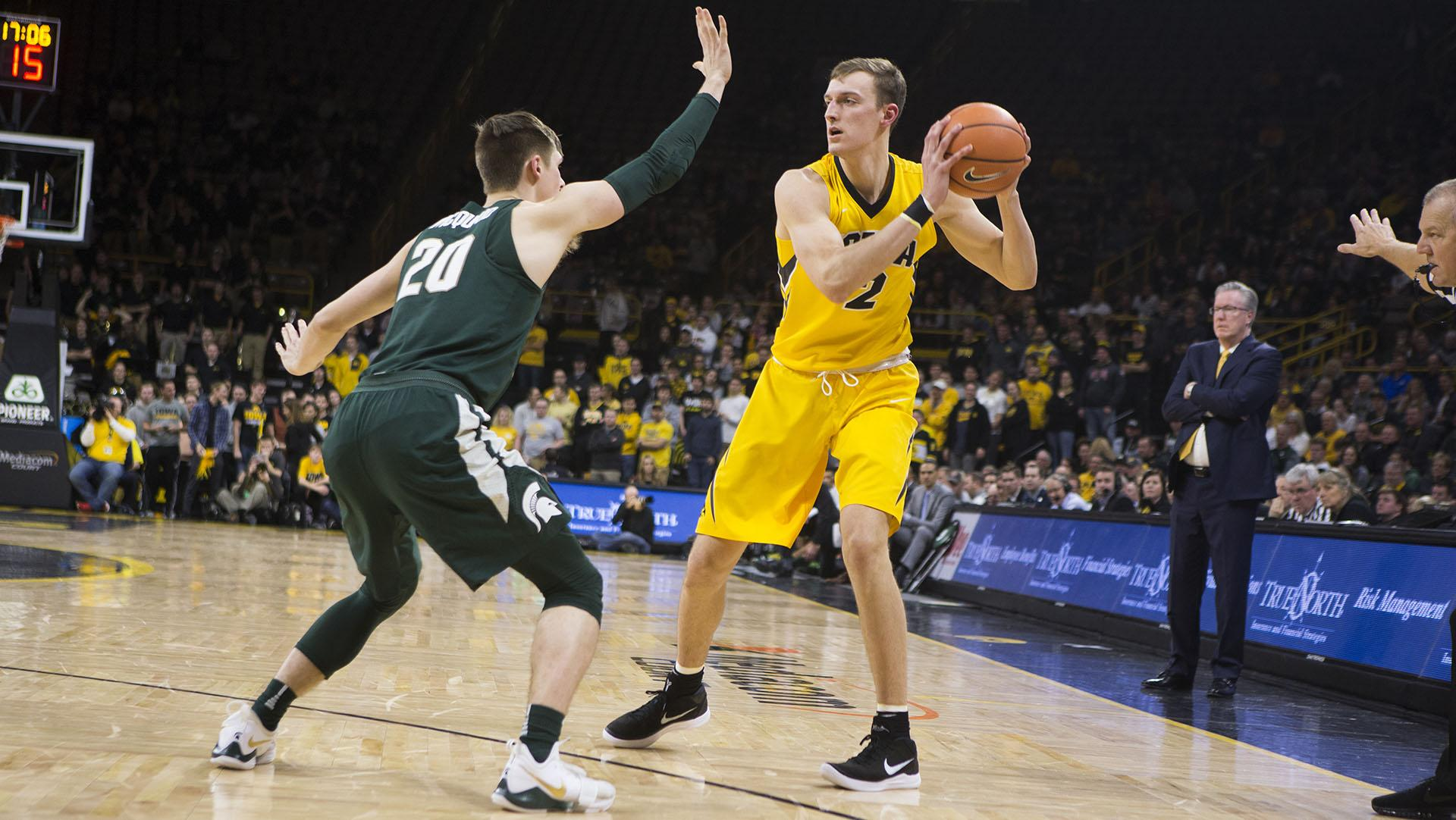 Iowa F Jack Nunge faces off with Michigan State G Matt McQuaid (20) during a basketball game between Iowa and Michigan State at Carver-Hawkeye Arena on Tuesday, Feb. 6, 2018. The Hawkeyes were defeated by the visiting Spartans, 96-93. (Shivansh Ahuja/The Daily Iowan)