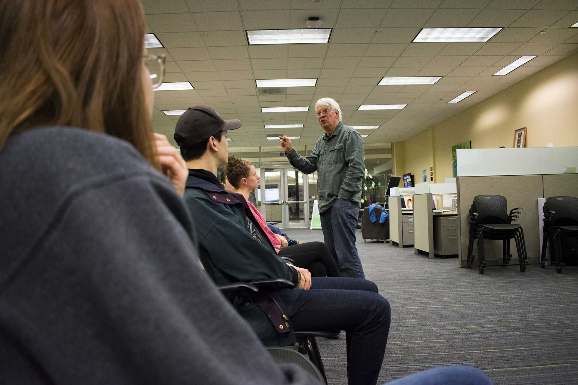Dave Collins, a professor of Marketing and Sustainability at the University of Iowa speaks to a crowd of students on February 22nd.  (Sid Peterson /The Daily Iowan)