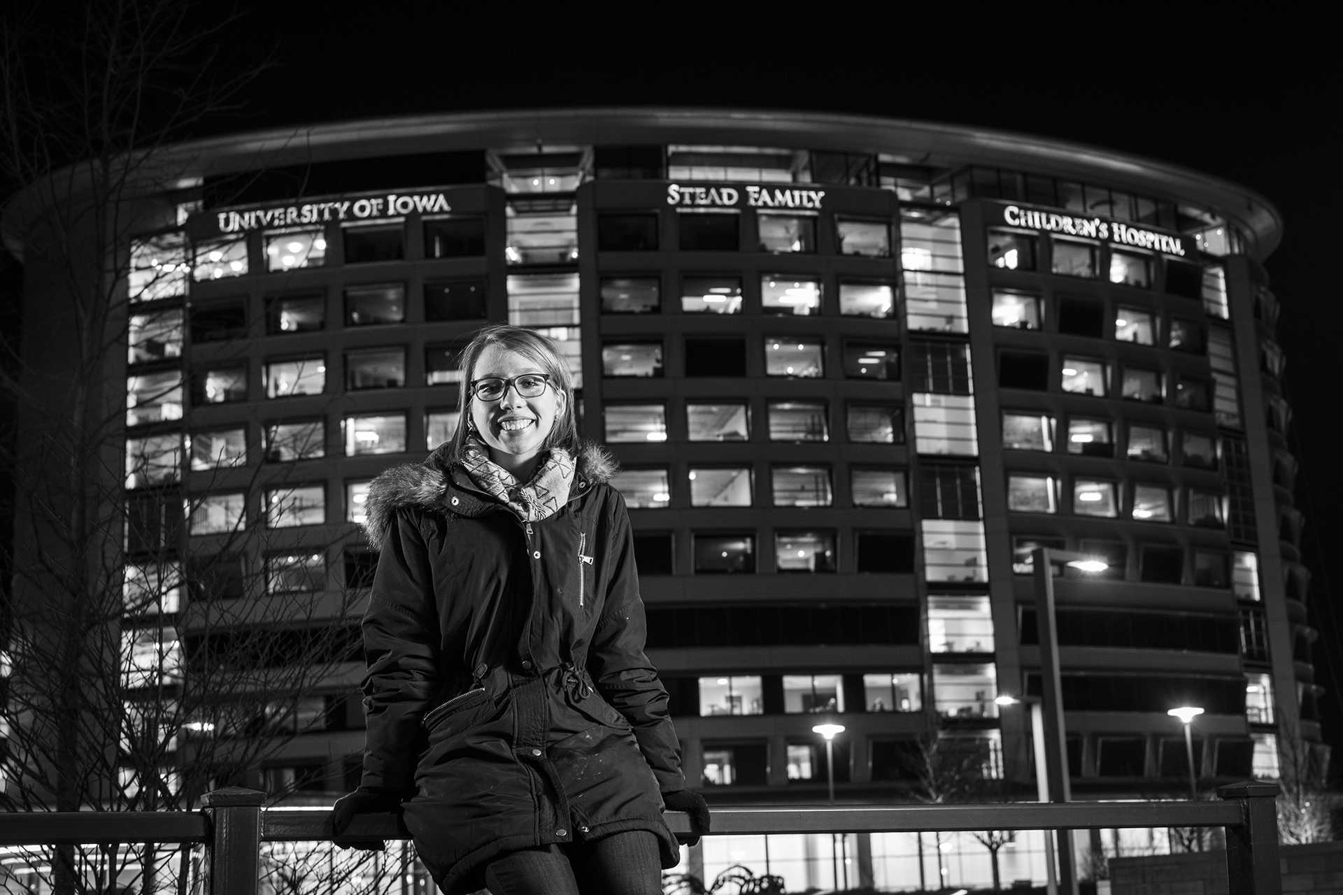 Melissa Trepa, a junior at the University of Iowa, poses for a portrait in front of the Stead Family Children's Hospital on Wednesday, Jan. 31, 2018. Trepa, a survivor of Hodgkin's lymphoma, celebrated her fifth year in remission this past October. She is participating in the UI Dance Marathon for the third year in a row, this weekend. (Matthew Finley/The Daily Iowan)