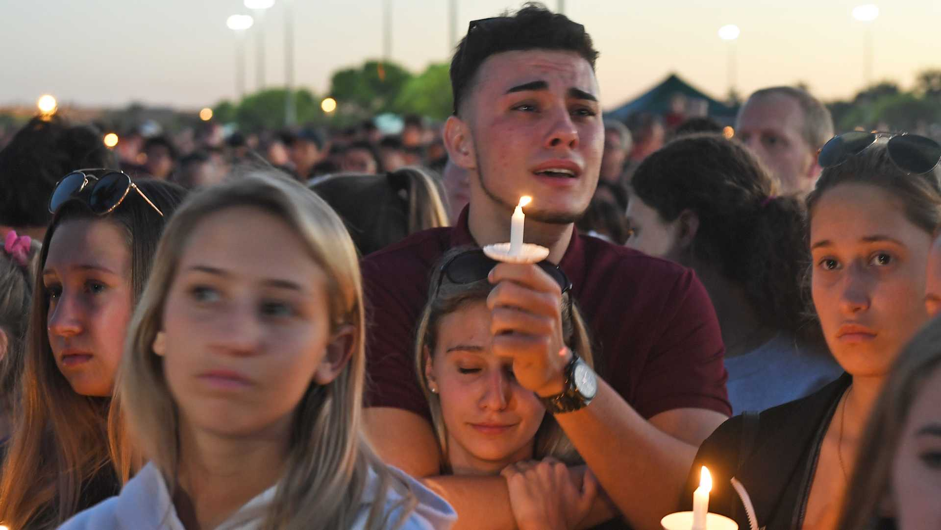 Mourners gather at a vigil that was held for the victims of the mass shooting at Marjory Stoneman Douglas High School in Parkland, Fla., on Thursday, Feb. 15, 2018. (Jim Rassol/Sun Sentinel/TNS)