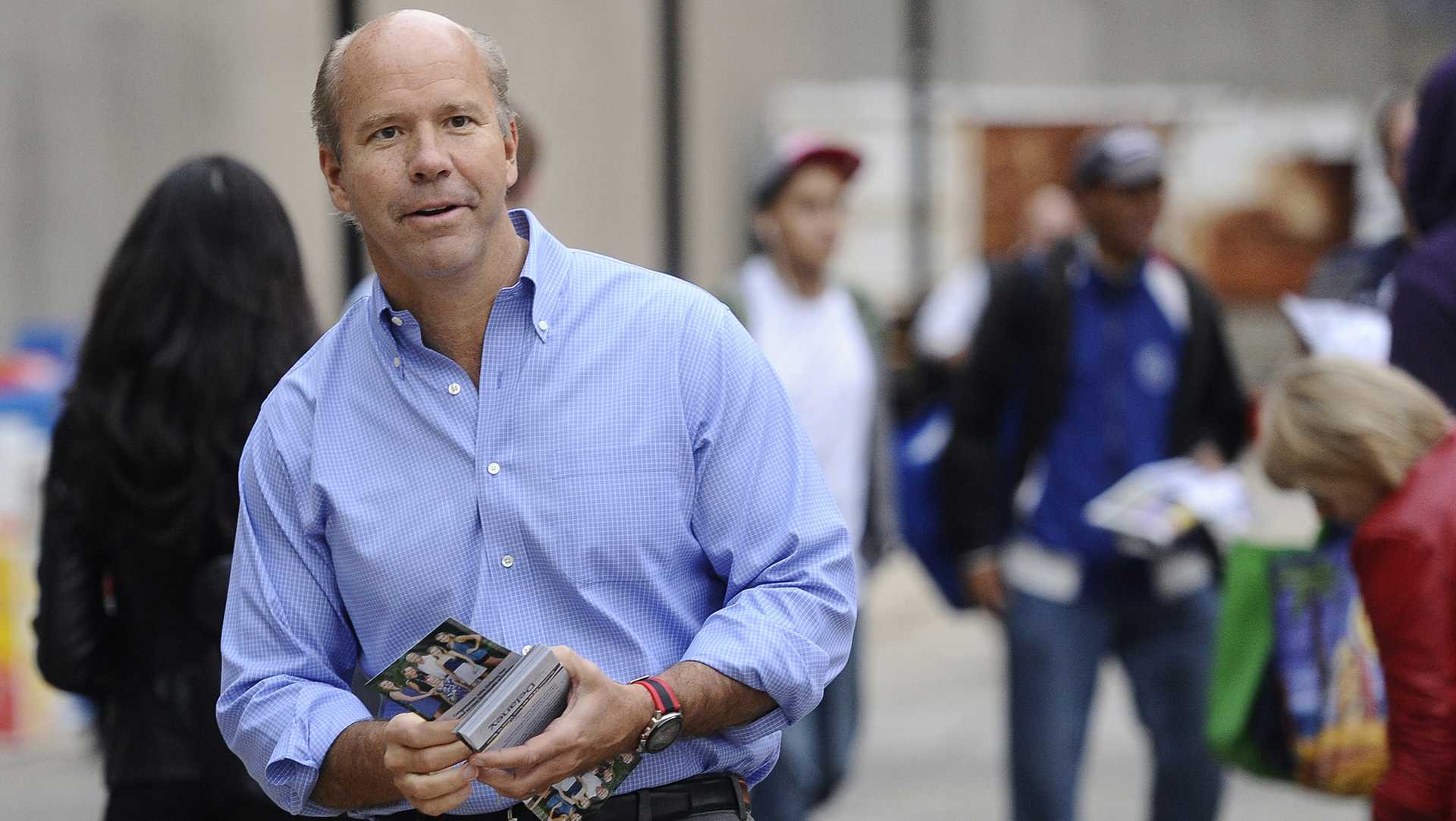 Congressman John Delaney campaigns at the Shady Grove Metro station in a file image from 2014. Delaney is running for president, but polling at zero. (Kim Hairston/Baltimore Sun/TNS)