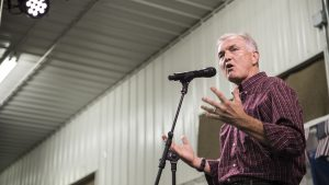 Gubernatorial candidate John Norris speaks during the Johnson County Democrats BBQ at the Johnson County Fairgrounds on Sunday, Oct. 15, 2017. Multiple gubernatorial candidates spoke at the event as well as guest speaker Rep. Dave Loebsack (D-Iowa). (Ben Smith/The Daily Iowan)