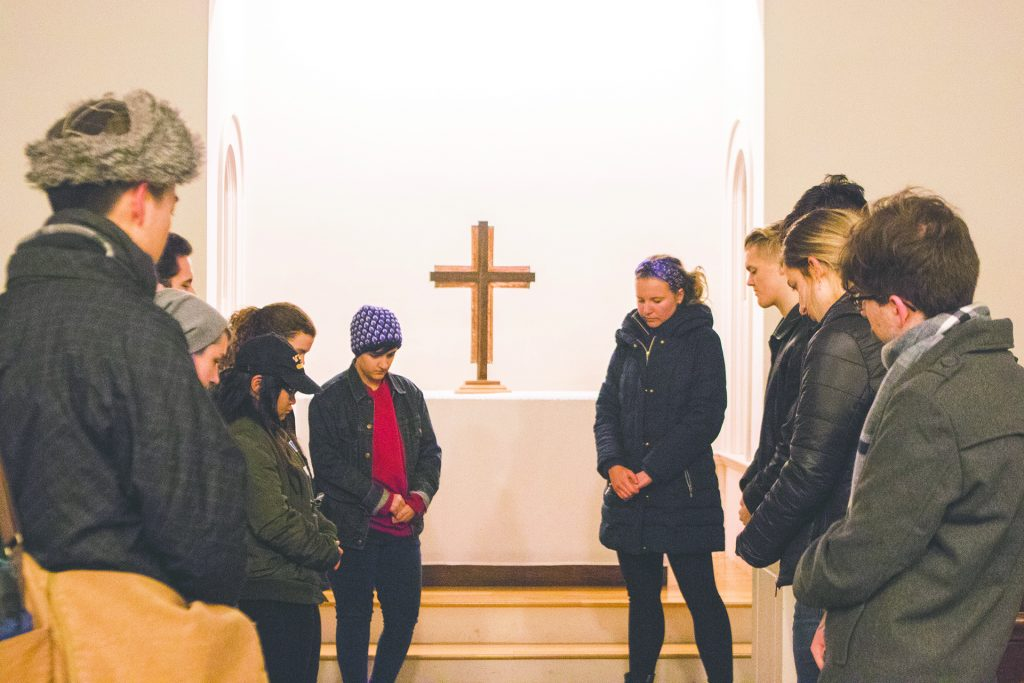UI+students+hold+a+moment+of+silence+during+the+Vigil+for+Victims+of+Gun+Violence+at+Danforth+Chapel+on+Tuesday%2C+Feb.+20%2C+2018.+The+event+was+coordinated+by+UI+Students+for+Human+Rights.+%28Lily+Smith%2FThe+Daily+Iowan%29