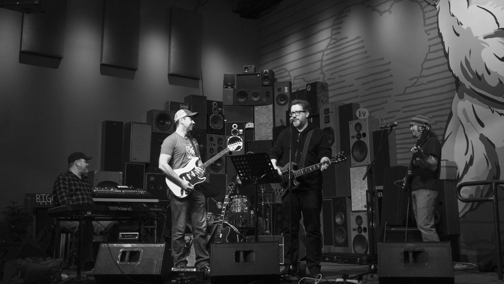 Jason T.Lewis and his bands perform at Big Grove Brewery on Friday,Feb. 9th, 2018. (Gaoyuan Pan/The Daily Iowan)
