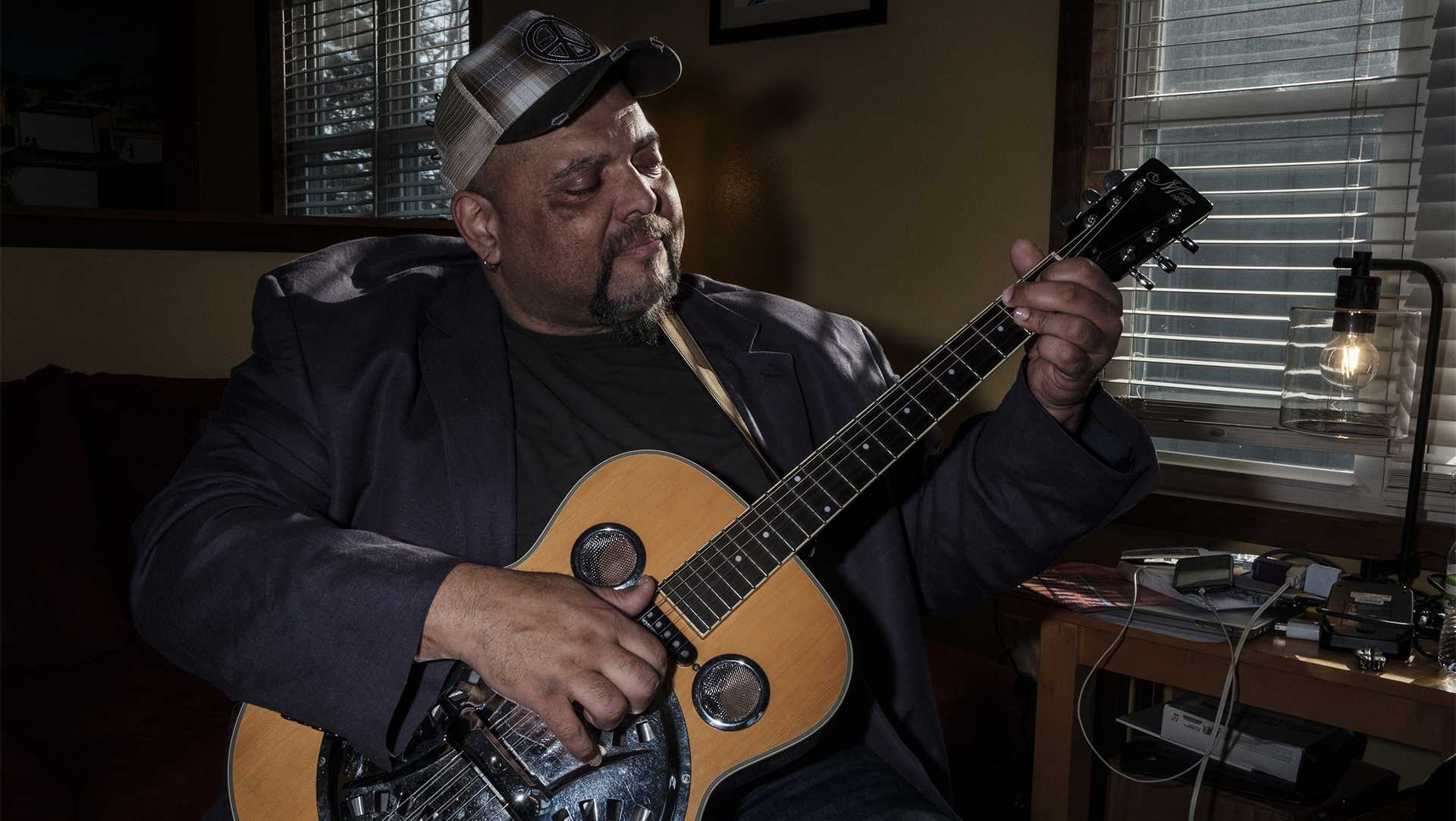 Blues musician Kevin Burt poses for a portrait in his Coralville home on Wednesday, Feb. 7, 2018. Burt recently won awards in the acoustic category at the International Blues Festival in Memphis. (Nick Rohlman/The Daily Iowan)