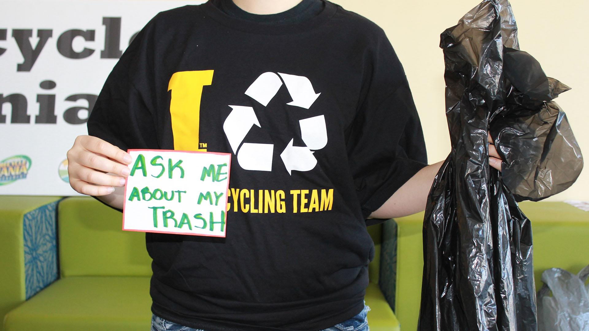 Recycle Mania Intern Elana Becker kicks off Earth Month in the Office of Sustainability on Monday, March 28, 2016. The Office of Sustainability just ended Recycle Mania, and is encouraging students to carry their trash bags over their backs around campus this week as a way to raise awareness of how much trash a single person can produce. (The Daily Iowan/McCall Radavich)