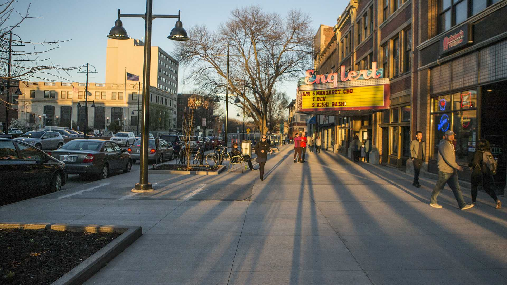 People walk the streets outside The Englert Theatre on Thursday, April 6, 2017. (Ben Allan Smith/The Daily Iowan)