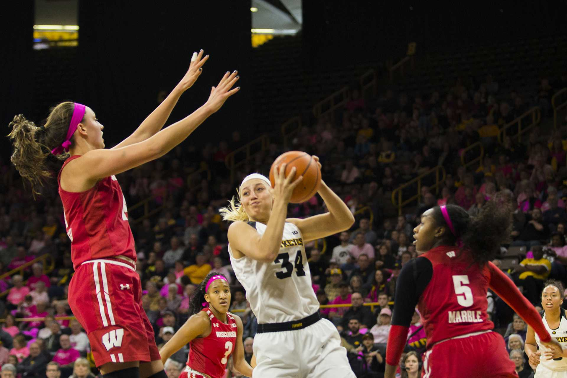 Iowa forward Carly Mohns drives to the hoop during the Iowa/Wisconsin basketball game at Carver-Hawkeye Arena on Sunday, Feb. 18, 2018. The Hawkeyes defeated the Badgers, 88-61. (Lily Smith/The Daily Iowan)