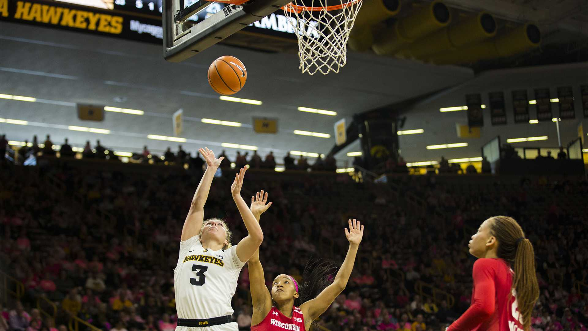 Iowa guard Makenzie Meyer attempts a shot during the Iowa/Wisconsin basketball game at Carver-Hawkeye Arena on Sunday, Feb. 18, 2018. The Hawkeyes defeated the Badgers, 88-61. (Lily Smith/The Daily Iowan)
