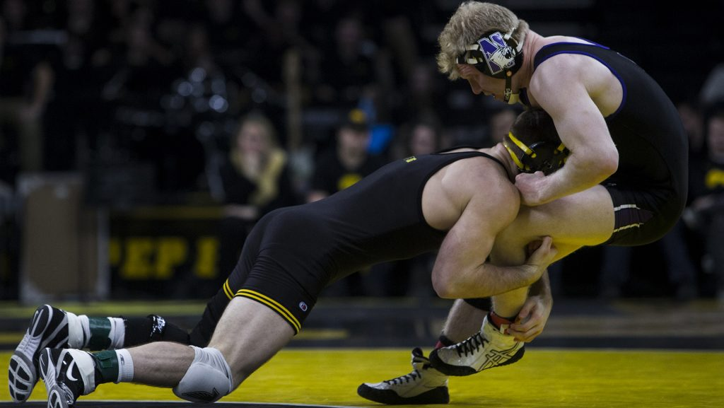 Iowa%27s+%237+ranked+165+pound+Alex+Marinelli+takes+down+Northwestern%27s+Michael+Sepke+during+the+Iowa+vs.+Northwestern+dual+meet+on+Sunday%2C+Feb.+4%2C+2018.+The+Hawkeyes+defeated+the+wildcats+33-2.+%28Nick+Rohlman%2FThe+Daily+Iowan%29