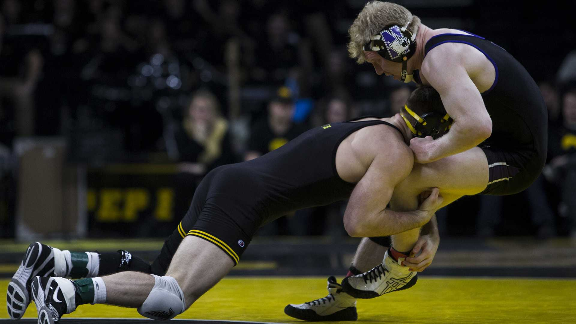 Iowa's #7 ranked 165 pound Alex Marinelli takes down Northwestern's Michael Sepke during the Iowa vs. Northwestern dual meet on Sunday, Feb. 4, 2018. The Hawkeyes defeated the wildcats 33-2. (Nick Rohlman/The Daily Iowan)