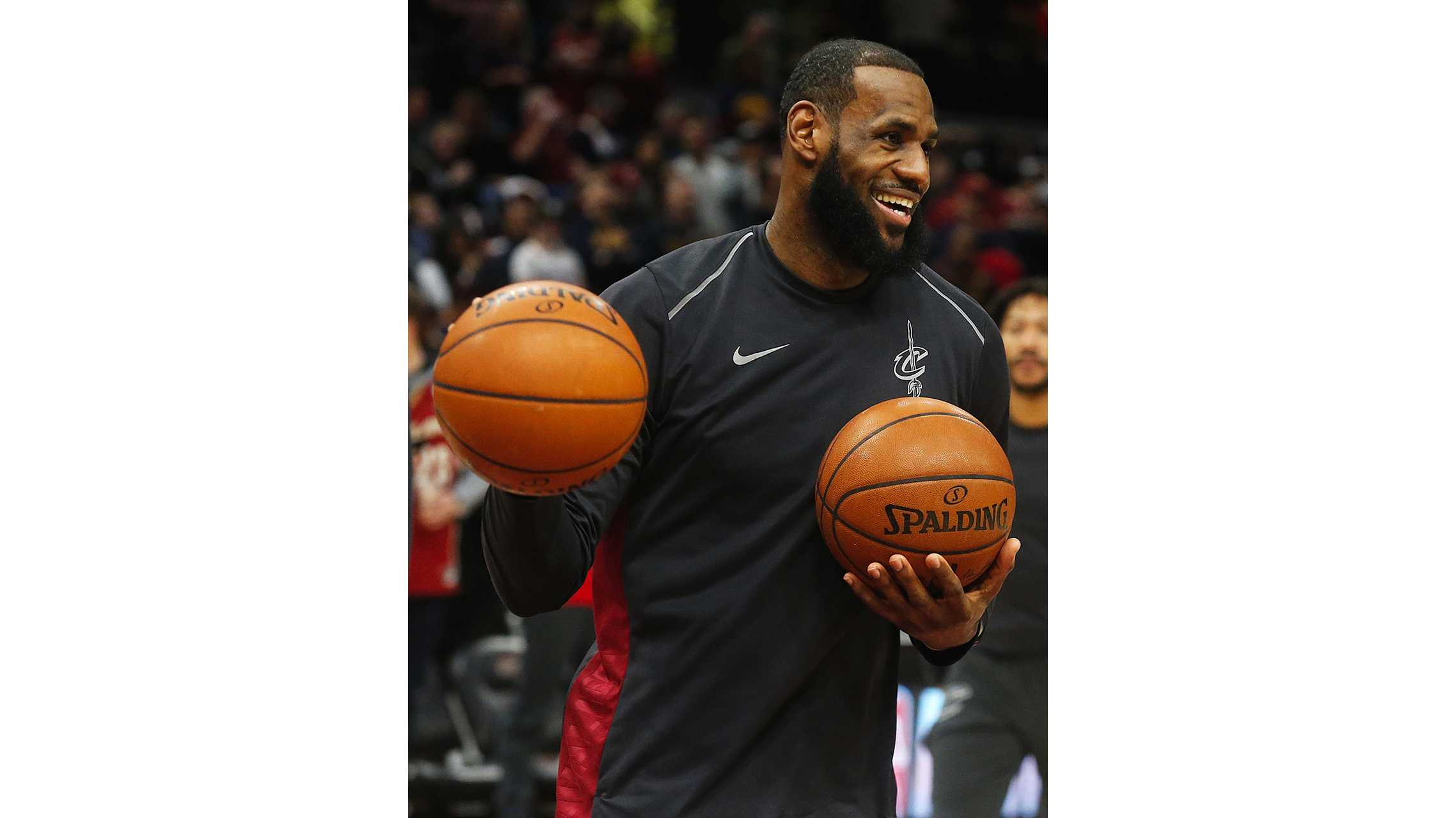 Cleveland Cavaliers forward LeBron James shares a laugh in warm-ups before taking on the Oklahoma City Thunder on Saturday, Jan. 20, 2018, at Quicken Loans Arena in Cleveland, Ohio. The Thunder won, 148-124. (Leah Klafczynski/Akron Beacon Journal/TNS)