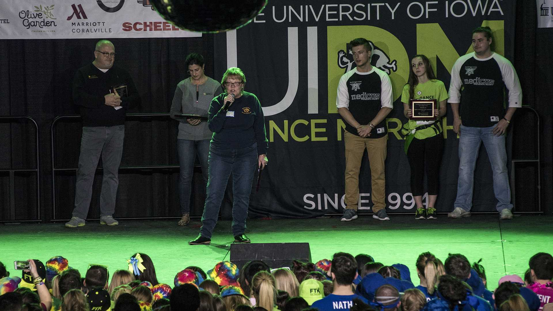 Mary Peterson presents awards for biggest individual fundraising efforts during UI Dance Marathon 24 inside the IMU on Saturday, Feb. 3, 2018. (Ben Allan Smith/The Daily Iowan)