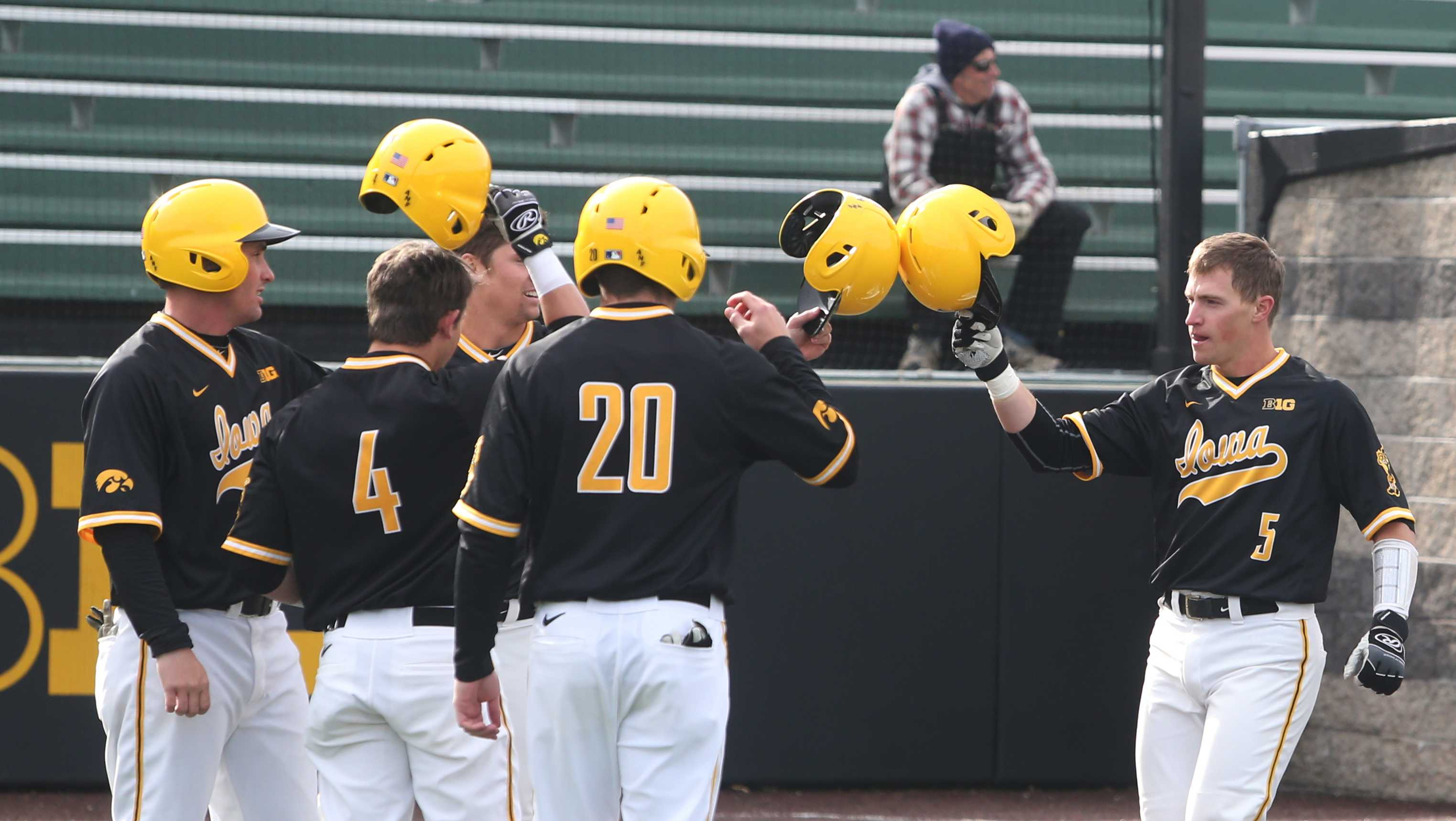 Iowa catcher Matt Hoeg celebrates with teammates after his grand slam during the game between the Bradley Braves and the Iowa Hawkeyes in Iowa City at Duane Banks Field on Wednesday, March 22, 2017. The Hawkeyes bats came alive to hit two grand slams and won 12-1. (The Daily Iowan/ Alex Kroeze)