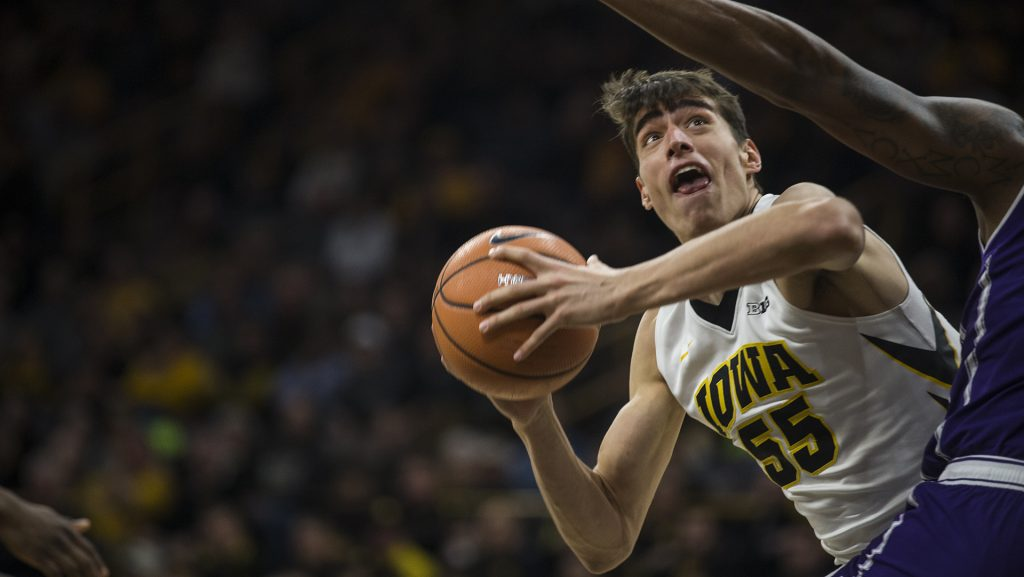 Iowa+forward+Luka+Garza+%2855%29+looks+for+an+open+shot+against+a+Northwester+defender+during+the+Senior+Day+men%27s+basketball+game+between+Iowa+and+Northwestern+at+Carver-Hawkeye+Arena+on+Sunday%2C+Feb.+25%2C+2018.+The+Hawkeyes+defeated+the+Wildcats+77-70.+%28Ben+Allan+Smith%2FThe+Daily+Iowan%29