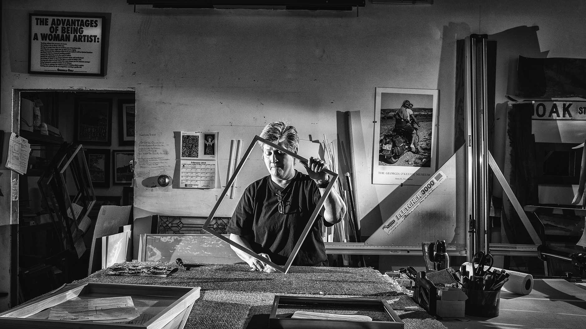 Iowa City resident and The Art Mission owner Kathleen Rash works on a frame in her workshop on Tuesday, Feb. 13, 2018. Kathleen opened the store in 1999, which acts as a gallery space with framing services on South Lynn Street. She has been open for business for 18 years but joked,